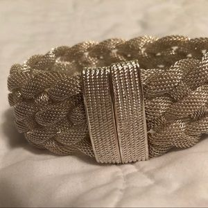 Shimmery white bracelet with magnets.